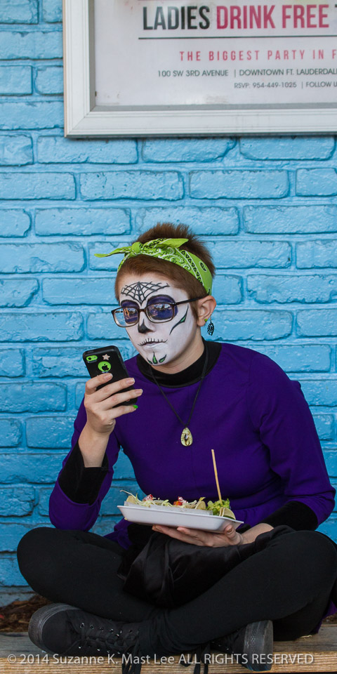 blue wall, celebrations, costume, Day of the Dead, eating, face paint, Florida < United States < North America, FOOD, Fort Lauderdale, HOLIDAY, phone, South Florida